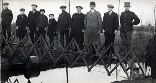 Men on a bridge possibly immigrating to a new culture this moving and building community in a new culture can be equated with social media