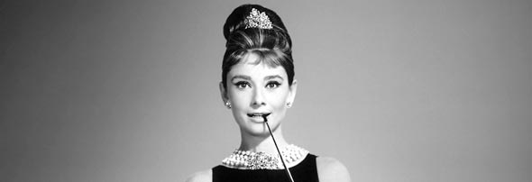 Idea Girl Media uses Audrey Hepburn modeling a little black dress as an example of blogging and audio as social media strategy and content marketing